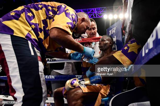 Guillermo Rigondeaux talks with his coach in between rounds during his Junior Lightweight bout against Vasiliy Lomachenko at Madison Square Garden on...