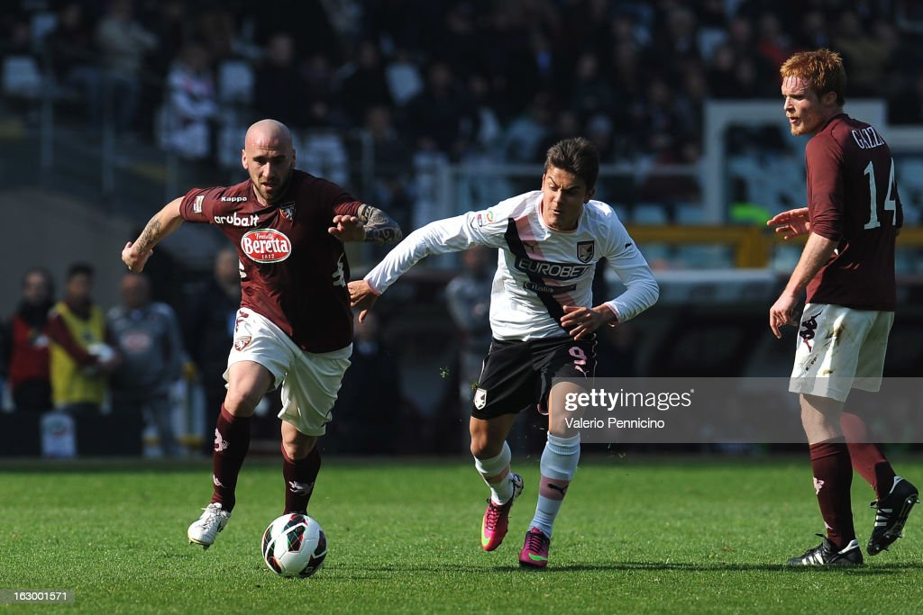 Guillermo Rodriguez (L) of Torino FC in action against Paulo Dybala of US Citta di Palermo during the Serie A match between Torino FC and US Citta di Palermo at Stadio Olimpico di Torino on March 3, 2013 in Turin, Italy.