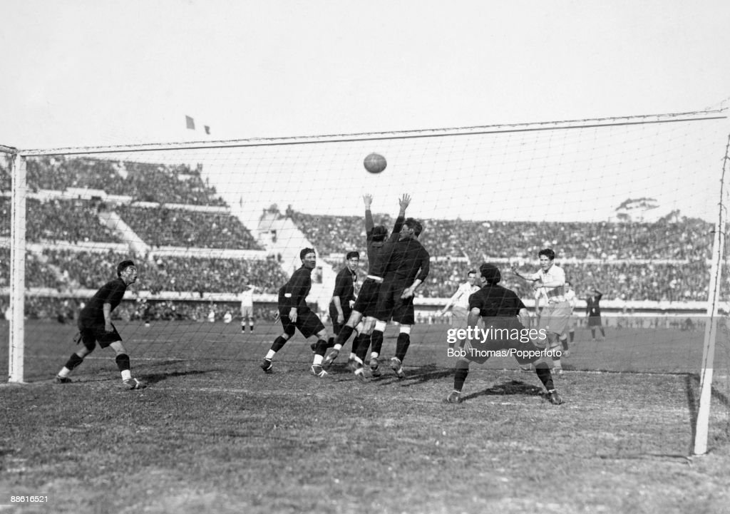 Guillermo Stabile (right) heads the ball through a crowd of Mexican defenders to score for Argentina during the FIFA World Cup match at the Estadio Centenario in Montevideo, 19th July 1930. Argentina won 6-3.