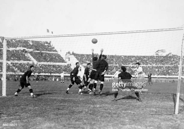 Guillermo Stabile heads the ball through a crowd of Mexican defenders to score for Argentina during the FIFA World Cup match at the Estadio...