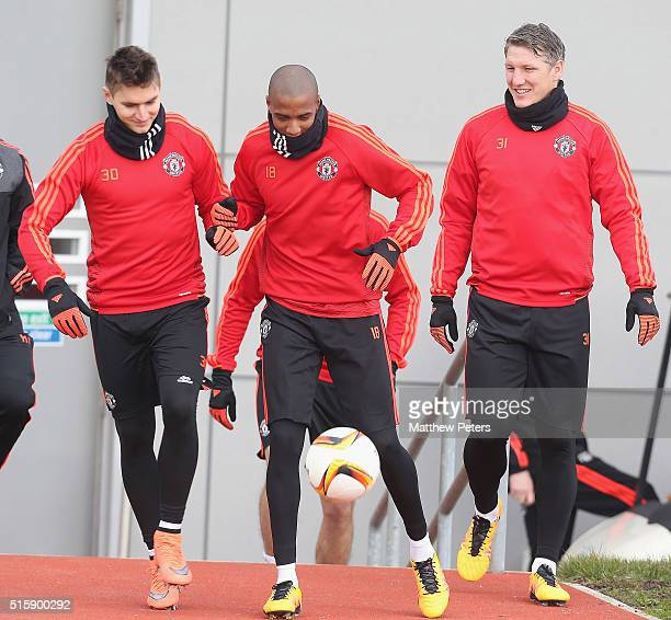 Guillermo Varela Ashley Young and Bastian Schweinsteiger of Manchester United in action during a first team training session ahead of their UEFA...