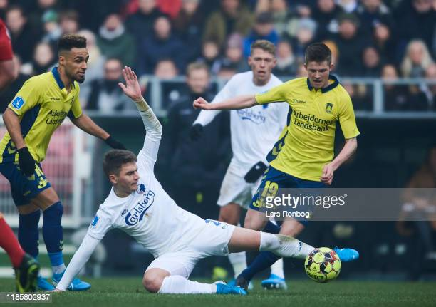 Guillermo Varela of FC Copenhagen and Morten Frendrup of Brondby IF compete for the ball during the Danish 3F Superliga match between FC Copenhagen...