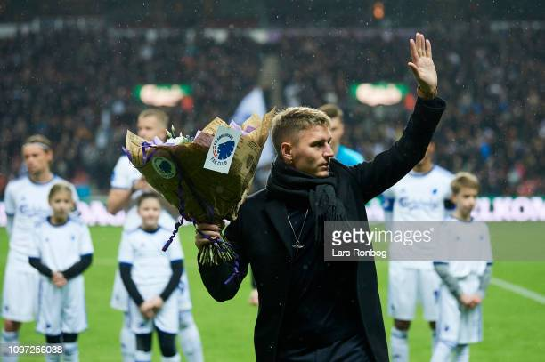 Guillermo Varela of FC Copenhagen receiving flowers prior to the Danish Superliga match between FC Copenhagen and OB Odense at Telia Parken Stadium...
