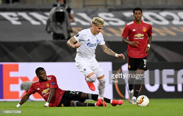 Guillermo Varela of FC Kobenhavn is challenged by Fred of Manchester United during the UEFA Europa League Quarter Final between Manchester United and...