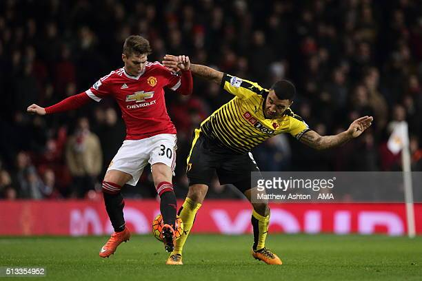 Guillermo Varela of Manchester United and Troy Deeney of Watford during the Barclays Premier League match between Manchester United and Watford at...