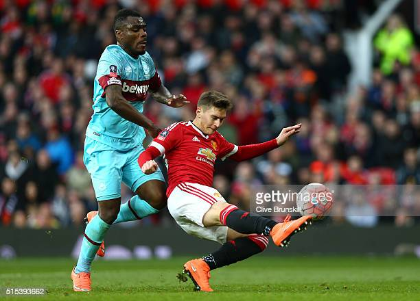 Guillermo Varela of Manchester United clears the ball from Emmanuel Emenike of West Ham United during the Emirates FA Cup sixth round match between...