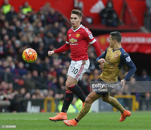Guillermo Varela of Manchester United in action with Alexis Sanchez of Arsenal during the Barclays Premier League match between Manchester United and...