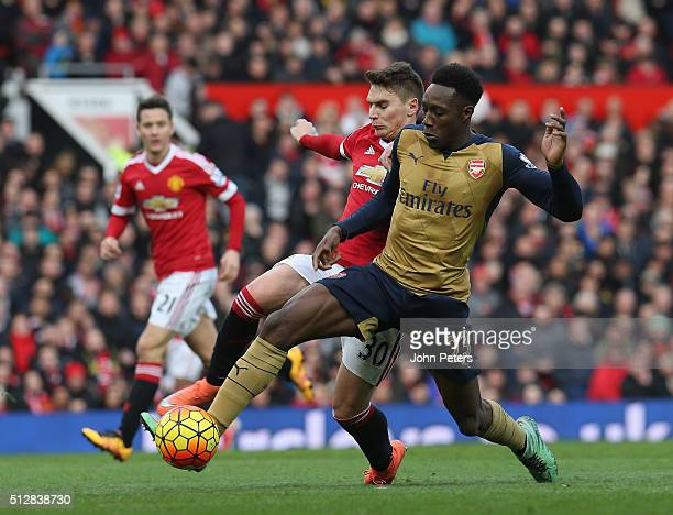 Guillermo Varela of Manchester United in action with Danny Welbeck of Arsenal during the Barclays Premier League match between Manchester United and...