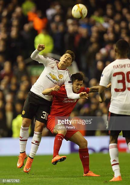 Guillermo Varela of Manchester United in action with Philippe Coutinho of Liverpool during the UEFA Europa League round of 16 first leg match between...