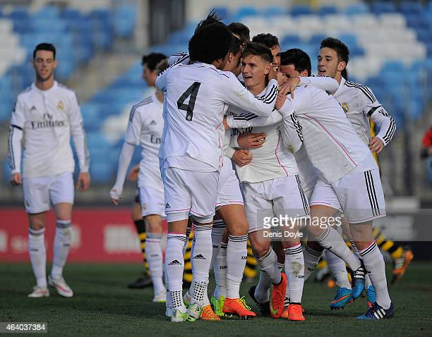 Guillermo Varela of Real Madrid Castilla celebrates with team mates after scoring his team's 3rd goal during the Segunda Division B match between...