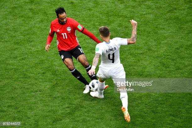 Guillermo Varela of Uruguay battles for possession with Kahraba of Egypt during the 2018 FIFA World Cup Russia group A match between Egypt and...