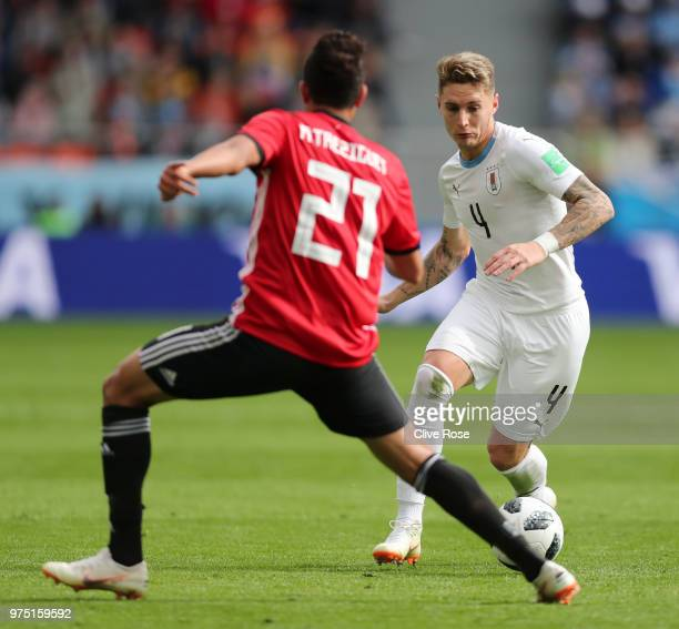 Guillermo Varela of Uruguay looks to pass the ball past Trezeguet of Egypt during the 2018 FIFA World Cup Russia group A match between Egypt and...