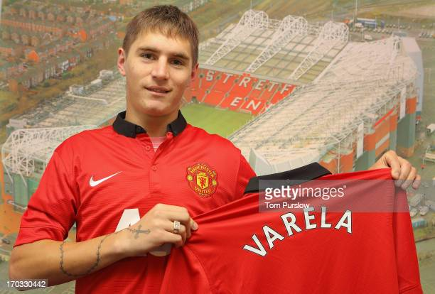 Guillermo Varela poses with a Manchester United shirt after signing for Manchester United at Carrington Training Ground on June 7 2013 in Manchester...