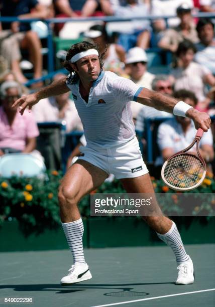 Guillermo Vilas of Argentina in action during a men's singles match at the US Open Tennis Championships at Flushing Meadow in New York City, circa...