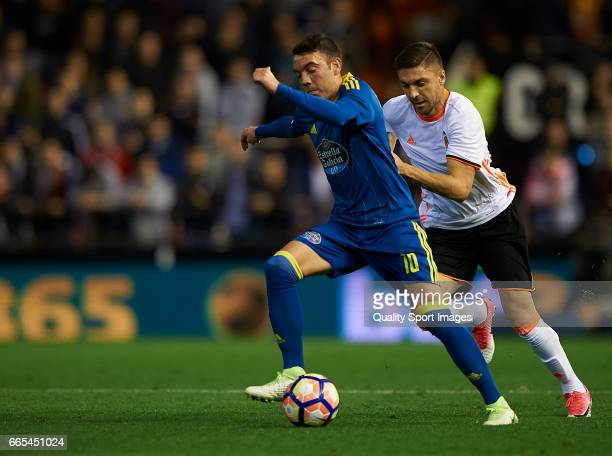 Guillherme Siqueira of Valencia competes for the ball with Iago Aspas of Celta de Vigo during the La Liga match between Valencia CF and RC Celta de...