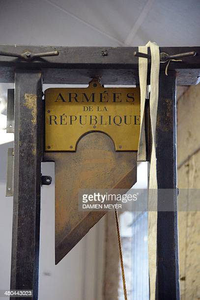A guillotine is pictured in its auction room in Nantes western France on March 25 2014 The guillotine will be auctioned on March 27 2014 and could be...