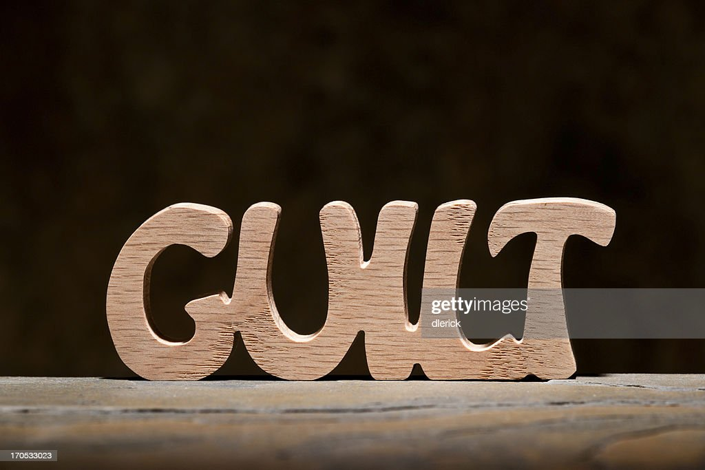 Guilt: Letters Handcut from Wood : Stock Photo