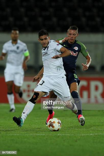 Guimaraes midfielder Guilherme Celis from Colombia vies with RB Salzburg forward Munas Dabbur from Greece for the ball possession during the match...