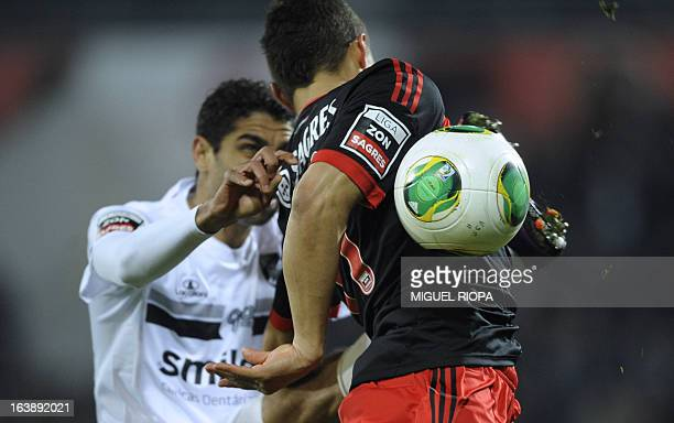 Guimaraes' Moroccan midfielder Issam El Adoua vies with Benfica's Brazilian forward Rodrigo Lima during the Portuguese league football match Vitoria...