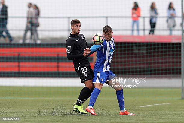 Guimaraes's forward Joao Vigario vies with Santa Iria forward Flecha during the Portuguese Cup match between Santa Iria and Guimaraes at Campo do...