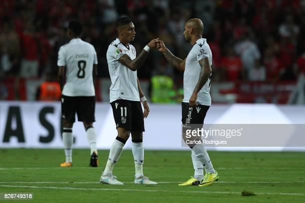 Guimaraes's forward Raphinha from Brasil celebrates scoring Vitoria Guimaraes goal with Guimaraes's forward Rafael Martins from Brasil during the...