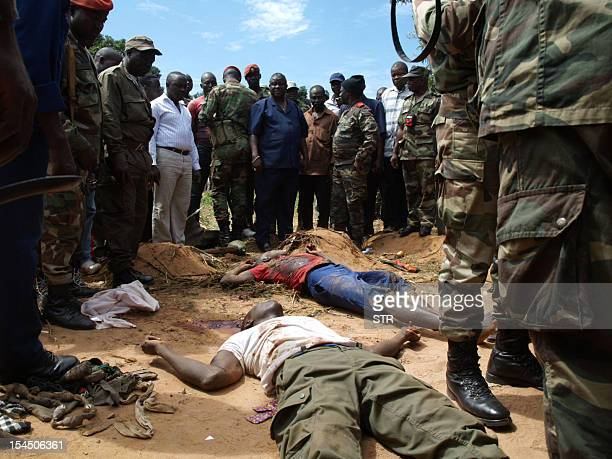 Guinea Bissau's army chief of staff General Antonio Indjai and soldiers stand next to dead bodies after gunmen raided a GuineaBissau army barracks...