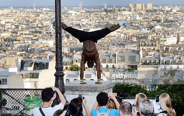 Guinea born Iya Traore a former football player juggler and acrobate performs in front of tourists with a ball near the Sacre Coeur basilica in the...
