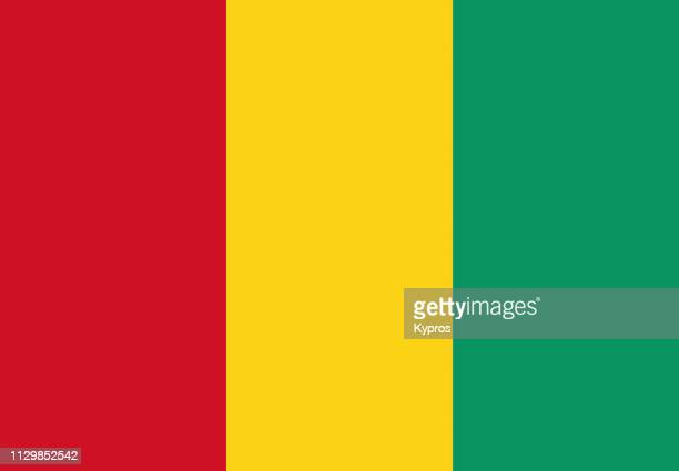 guinea flag - guinea stock pictures, royalty-free photos & images
