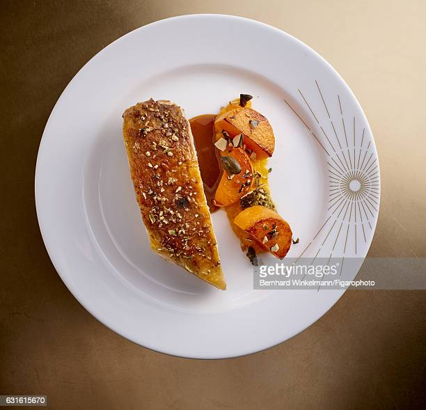 Guinea fowl supreme with spices and melted squash is photographed for Madame Figaro on November 25 2016 in Versailles France From Alain Ducasse's Ore...
