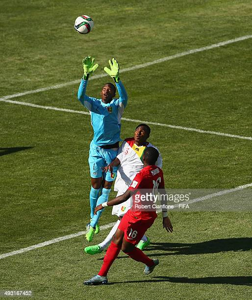 Guinea goalkeeper Moussa Camara leaps for the ball during the FIFA U17 World Cup Group B match between England and Guinea at Estadio Francisco...