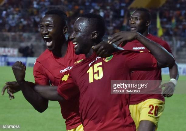 Guinea National football team players celebrate their goal during the 2019 African Cup of Nations qualifyer football match between Ivory Coast and...