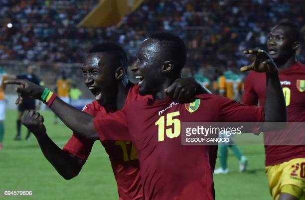 Guinea National football team players Naby Deco Keita and Alkhaly Bangoura celebrates their goal during the 2019 African Cup of Nations qualifyer...