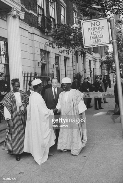 Guinea officials arriving at the Soviet Embassy for an AfroAsian luncheon