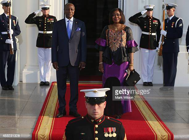 Guinea President Alpha Conde and spouse Djene Kaba Conde arrive at the North Portico of the White House for a State Dinner on the occasion of the US...