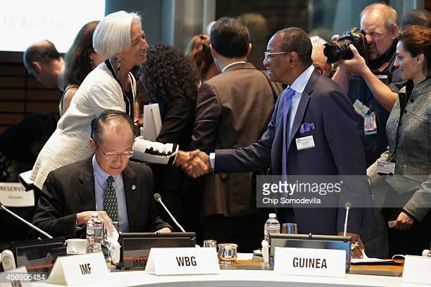 Guinea President Alpha Conde greets International Monetary Fund Managing Director Christine Lagarde with World Bank Group President Jim Yong Kim...