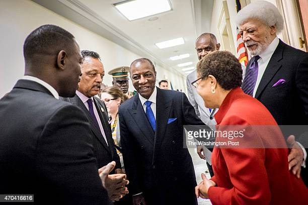 Guinea President Alpha Conde mingles with Rev Jesse Jackson Rep Karen Bass and and Ron Dellums former Mayor of Oakland and former Member of Congress...