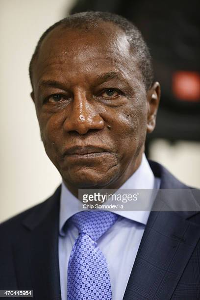 Guinea President Alpha Conde participates in a news conference about the ongoing fight against the Ebola outbreak in West Africa during the World...