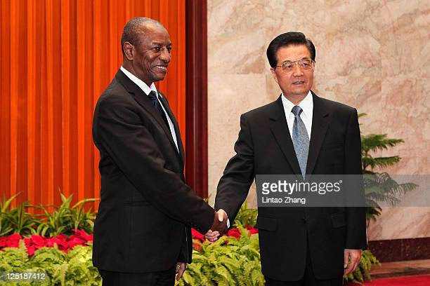 Guinea President Alpha Conde shakes hands with Chinese President Hu Jintao at the Great Hall of People on September 16 2011 in Beijing China...