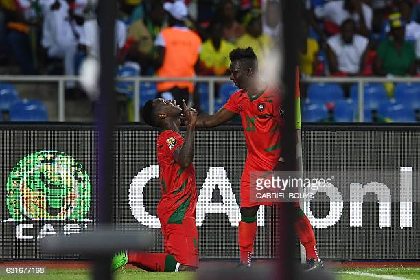 GuineaBissau's defender Juary Soares celebrates with GuineaBissau's forward Aldair after scoring a goal during the 2017 Africa Cup of Nations group A...