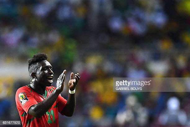 GuineaBissau's forward Aldair acknowledges supporters at the end of the 2017 Africa Cup of Nations group A football match between Gabon and...