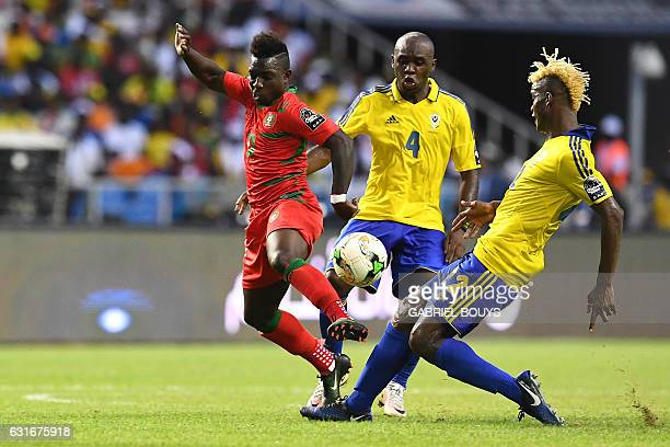 GuineaBissau's forward Aldair challenges Gabon's midfielders Merlin Tandjigora and Gabon's midfielder Didier Ibrahim Ndong during the 2017 Africa Cup...