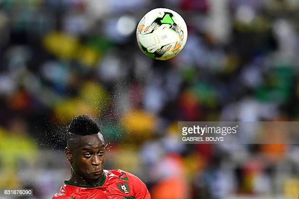 GuineaBissau's forward Frederic Mendy heads the ball during the 2017 Africa Cup of Nations group A football match between Gabon and GuineaBissau at...