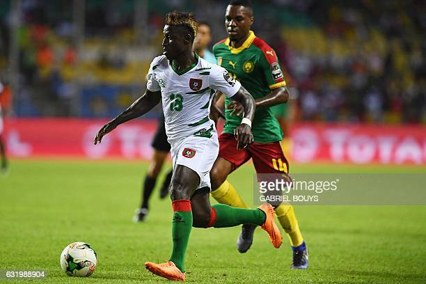 GuineaBissau's forward Piqueti advances with the ball past Cameroon's midfielder Georges Mandjeck before scoring a goal during the 2017 Africa Cup of...