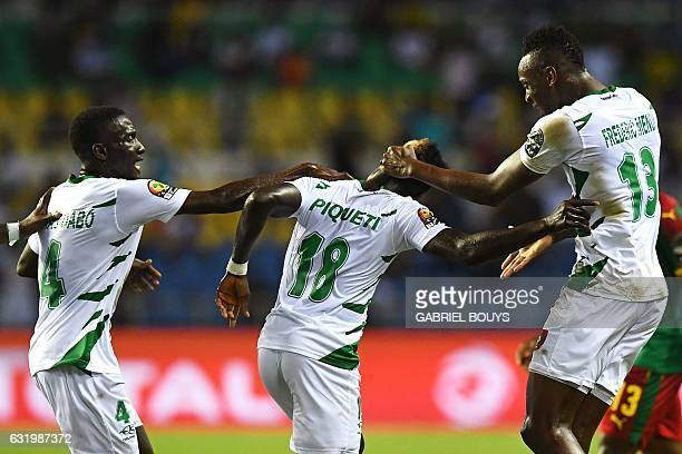 GuineaBissau's forward Piqueti celebrates with teammates after scoring a goal during the 2017 Africa Cup of Nations group A football match between...
