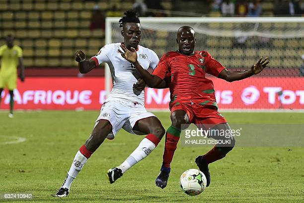 GuineaBissau's midfielder Sana challenges Burkina Faso's forward Bertrand Traore during the 2017 Africa Cup of Nations group A football match between...
