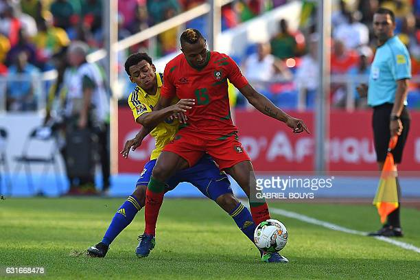 GuineaBissau's midfielder Toni Silva challenges Gabon's defender Johann Obiang during the 2017 Africa Cup of Nations group A football match between...
