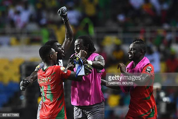 GuineaBissau's players celebrate a last minute goal at the end of the 2017 Africa Cup of Nations group A football match between Gabon and...