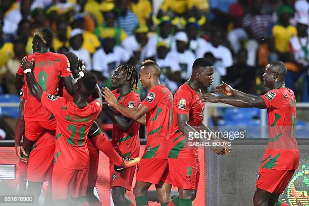 GuineaBissau's players celebrate after scoring a goal during the 2017 Africa Cup of Nations group A football match between Gabon and GuineaBissau at...
