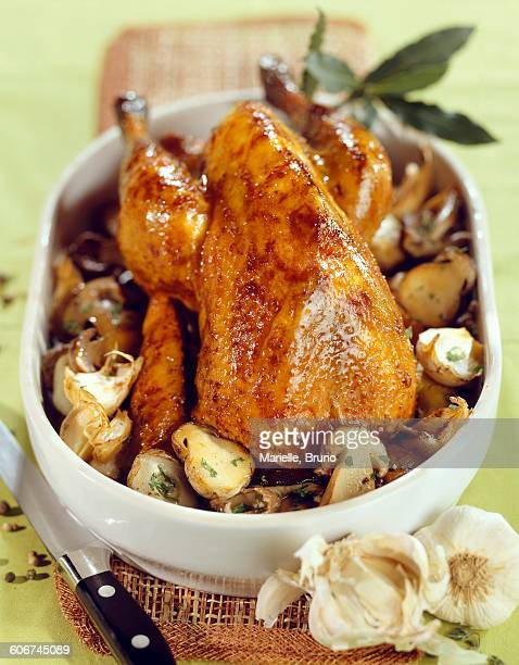 guinea-fowl with ceps and garlic - guinea fowl stock pictures, royalty-free photos & images