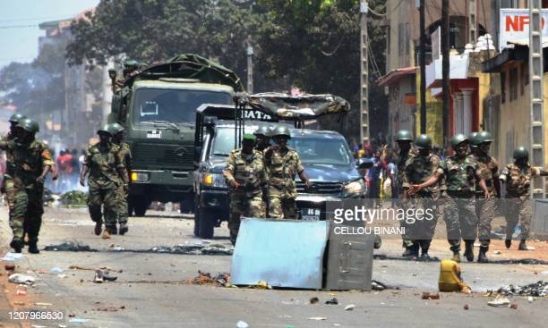 Guinean army forces patrol in the street in Conakry on March 22 2020 during a constitutional referendum in the country Guinean President Alpha Condé...